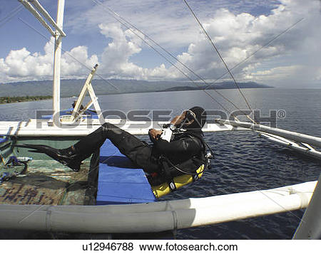 Pictures of Diver making a back roll of a local dive boat called a.