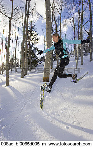 Stock Photo of Woman snowshoeing through Dixie National Forest.