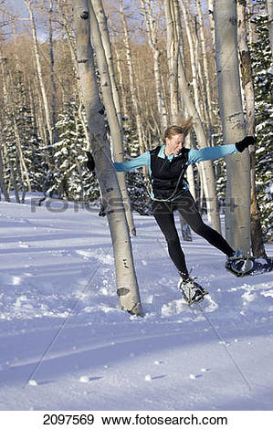 Stock Photograph of Woman Snowshoeing Through Dixie National.