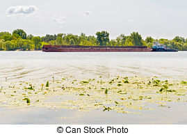 Stock Images of A tugboat assisting a river barge on the Dnieper.