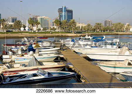 Stock Images of Boats at dock with buildings in background, Doha.