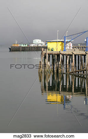 Stock Photo of Colorful dock buildings in harbor Crescent City.