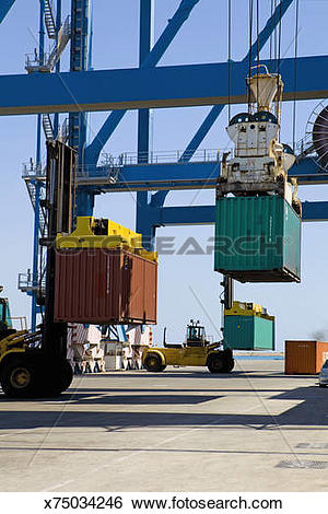 Stock Images of Cyprus, Limassol, Forklift trucks moving.