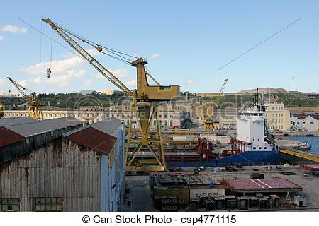 Stock Images of Malta dockyard during the day with cranes and.