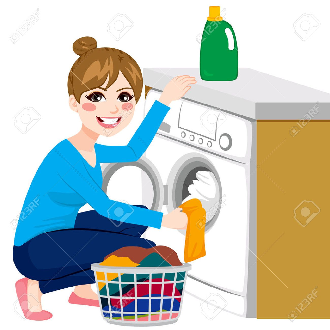 Beautiful young woman doing laundry putting dirty clothes on...