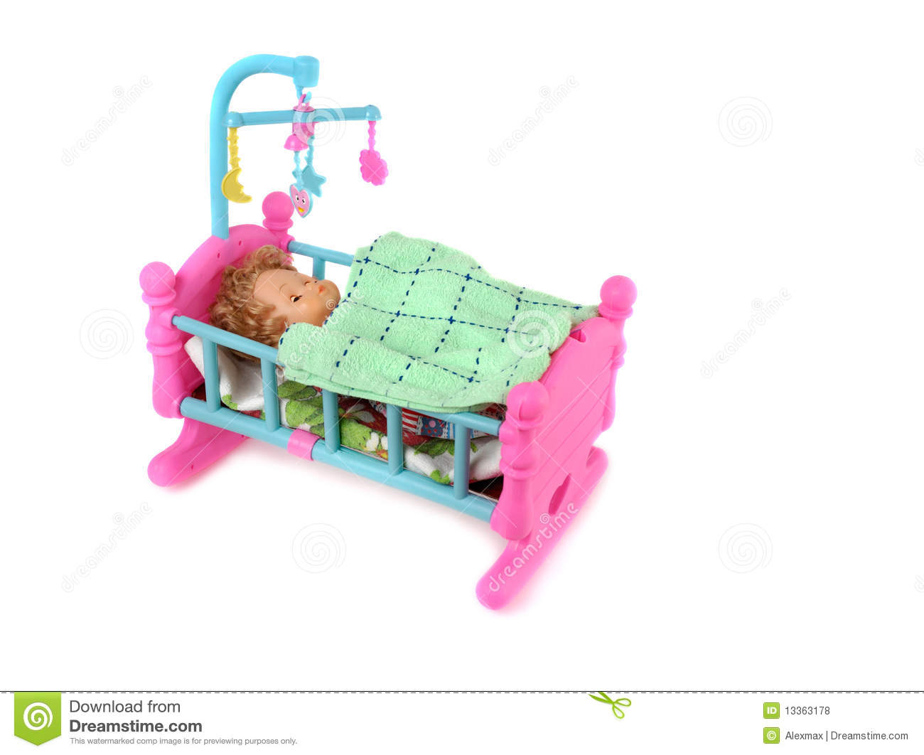 Baby Doll In Bed Royalty Free Stock Photos.