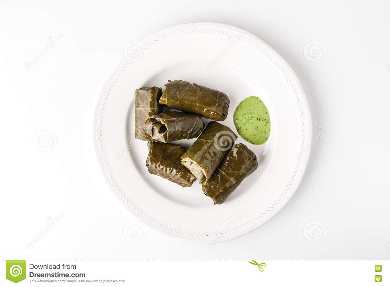 Dolma With Basil Sauce On A White Ceramic Plate Stock Photo.