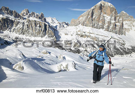 Stock Photo of Italy, Dolomite alps, woman with ski walking in.