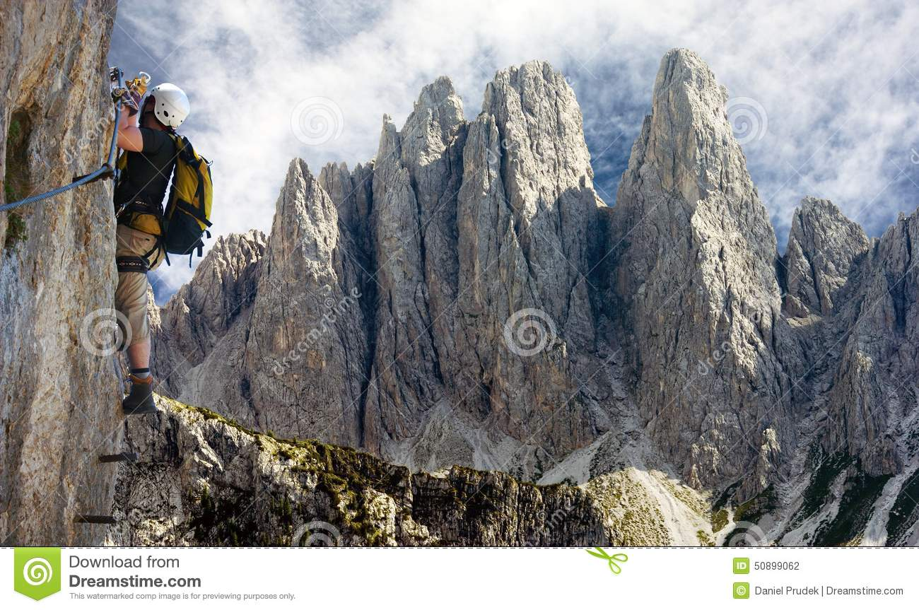 Climber On Via Ferrata Or Klettersteig In Italy Stock Photo.
