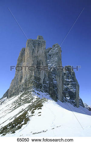 Stock Photography of Low angle view of rock formation, Tre Cime de.