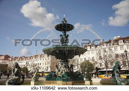 Stock Photo of fountain on the square Praca de Dom Pedro IV or.