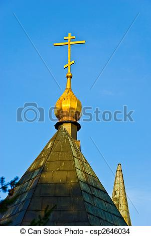 Stock Photo of golden dome of the church roof orthodox cross at.