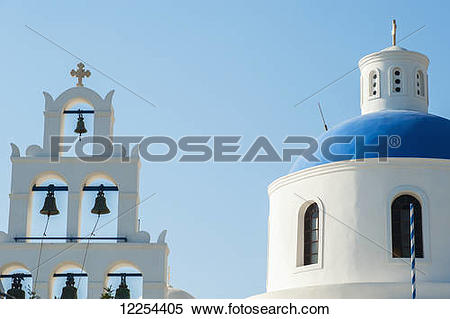 Stock Image of Church domed roof and bells; Oia, Santorini, Greece.