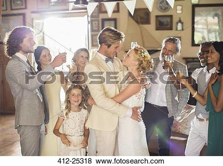 Pictures of Bridegroom embracing bride during wedding reception in.