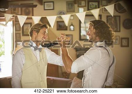 Stock Photography of Bridegroom and best man holding hands in.