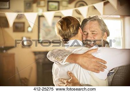 Stock Image of Best man embracing bridegroom in domestic room 412.