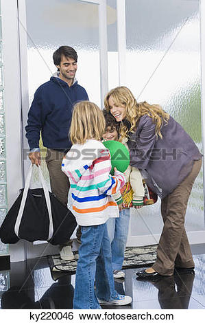 Stock Images of Woman greeting her children and husband at the.