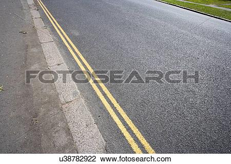 Stock Photo of Double yellow line on London street u38782922.