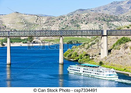 Stock Photography of railway viaduct and cruise ship in Pocinho.