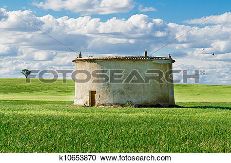 Stock Photography of Cloudy wheat Field and Dovecote k10653870.