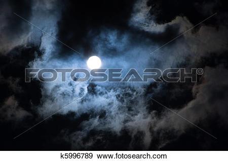 Stock Photograph of Sun shining through dramatic clouds, looks.
