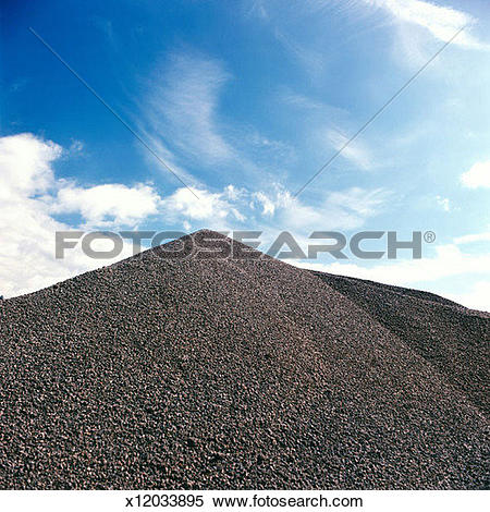 Stock Image of Gravel Pile with Dramatic Sky x12033895.