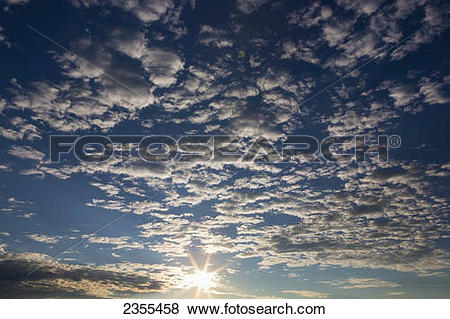 Pictures of Dramatic Sky At Sunrise With Sun Burst, Small Puffy.