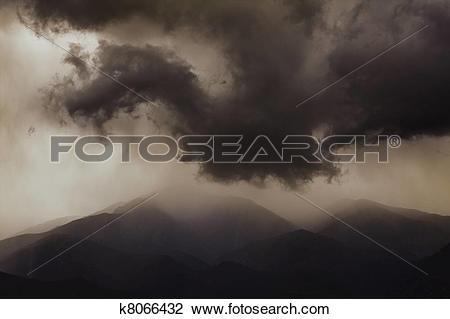 Stock Photo of Dark ominous clouds. Dramatic sky. k8066432.