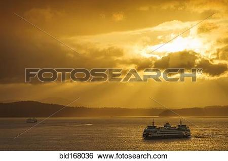 Stock Images of Ferry on ocean water under dramatic sky bld168036.