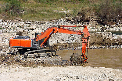 Excavator Dredging Sediment Mud Stock Images.