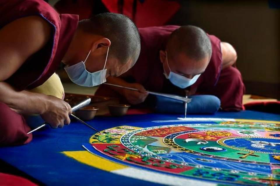 Tibetan monks from the Drepung Gomang Monastery Visit Coral.