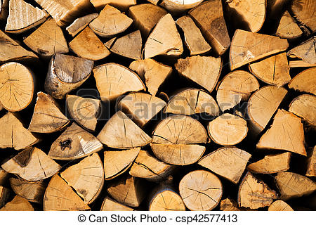 Stock Photography of Stacked woodpile of cut and split dried logs.