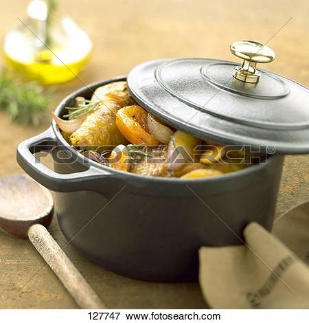 Picture of Chicken and dried fruit cooked in a casserole dish.