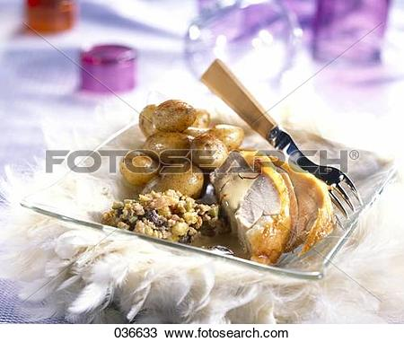 Stock Photo of Turkey with dried fruit stuffing and potatoes.