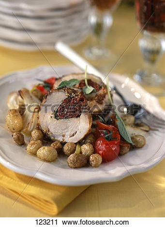 Stock Photography of Rolled veal with dried tomatoes,traditional.