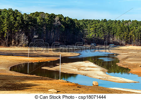 Stock Photo of Dried up lake with docks on ground.