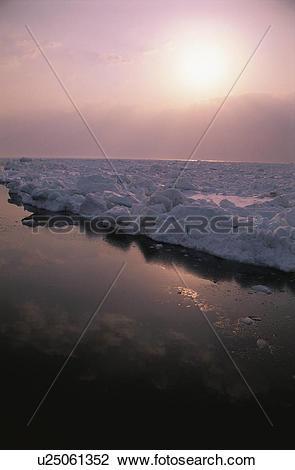 Stock Photo of Drift Ice And The Morning Sun u25061352.