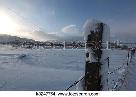 Stock Photo of Early moning snow drift k8247764.