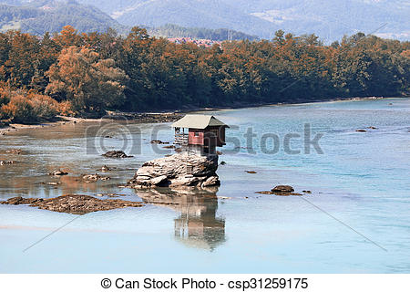 Picture of house on rock Drina river Serbia landscape csp31259175.
