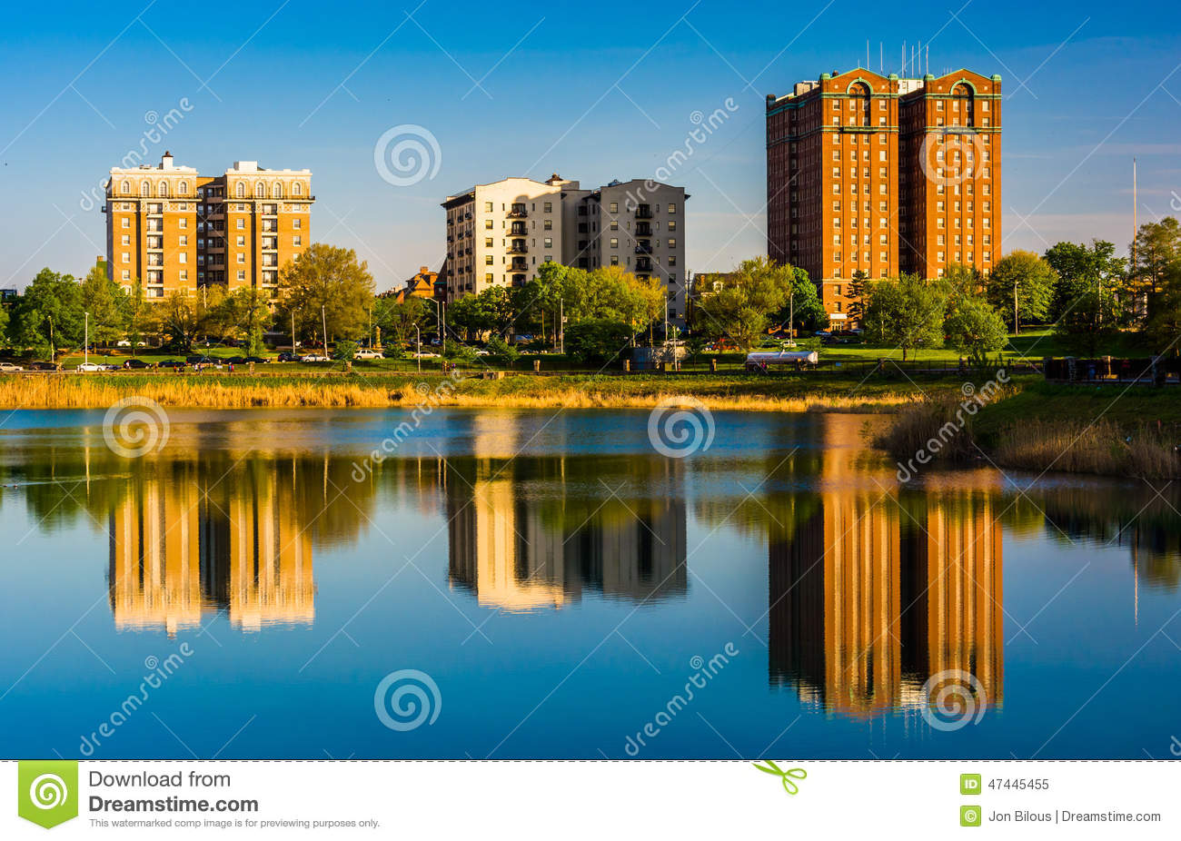 Reflections Of Buildings In Druid Lake, At Druid Hill Park, In B.