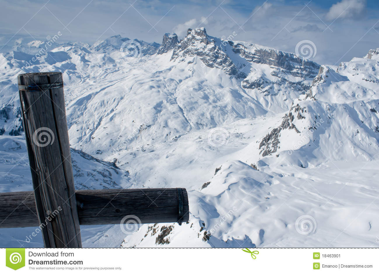 Swiss Alps In Winter With Cross On Peak Stock Image.