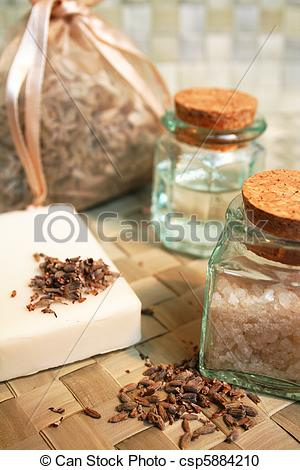 Stock Photography of Bar of natural soap, bottle of essential oil.