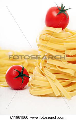Stock Photography of Dry pasta and cherry tomatoes composition.