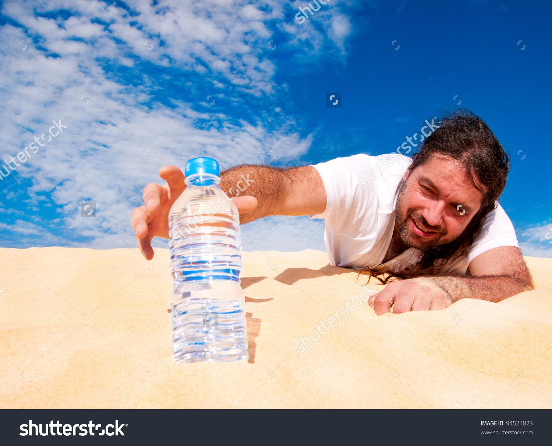 Thirsty Man Desert Reaches Bottle Water Stock Photo 94524823.