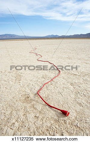 Stock Image of Electric cord in dry lake bed x11127235.