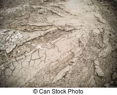 Stock Photo of Dry Cracked Mud With Tire Tracks.