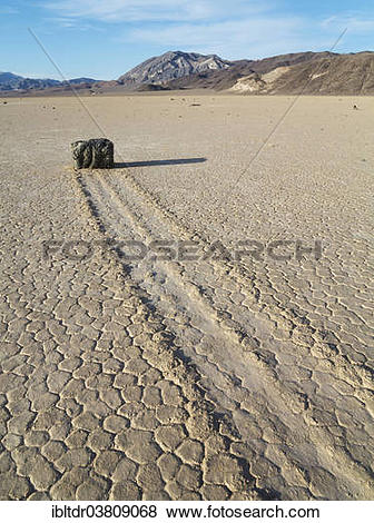 """Pictures of """"Track created by one of the mysterious moving rocks."""
