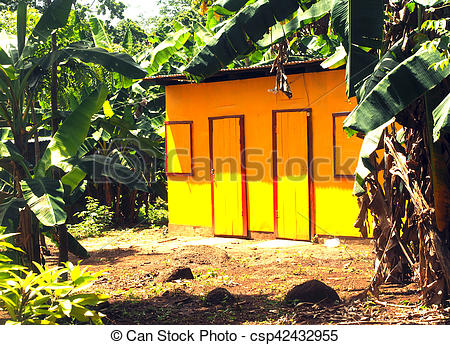 Stock Images of zinc sheet metal house in jungle with laundry.