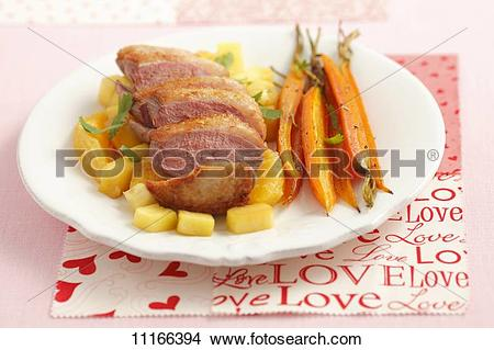 Stock Photo of Duck breast with pineapple, oranges and baby.