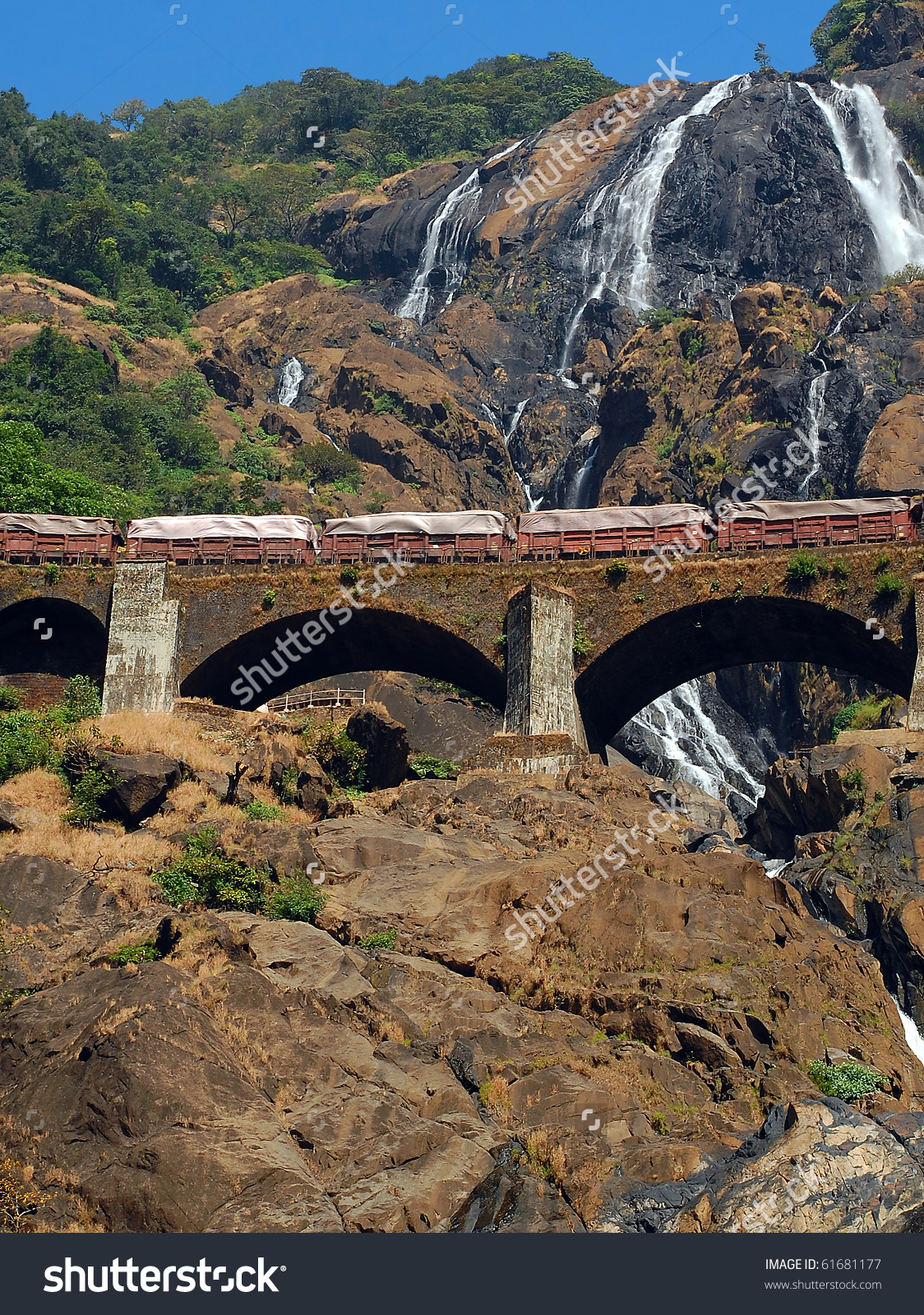 Train On Railroad Bridge Background Dudhsagar Stock Photo 61681177.